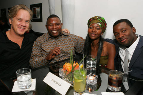Tim Robbins, Patrick Chamusso, his wife Connie and Derek Luke at the Focus Features'